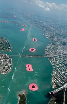 Installation - Surrounded Islands was completed in Biscayne Bay. Eleven of the islands situated in the area were surrounded with 6.5 million square feet of floating pink woven polypropylene fabric covering the surface of the water and extending out 200 feet  from each island into the bay.