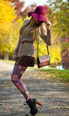 belted sweater over skirt + patterned tights