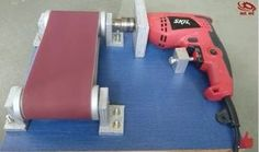 Drill Powered Belt Sander - Homemade drill powered belt sander constructed from surplus wooden boards, nuts, bolts, sandpaper, and a drill. Carpentry Tools, Carpentry Projects, Wood Projects, Woodworking Workshop, Woodworking Jigs, Woodworking Classes, Wood Tools, Diy Tools, Diy Belt Sander