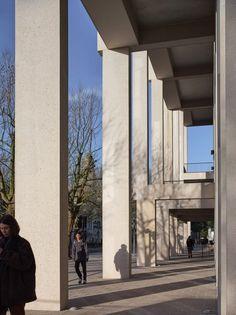 A long colonnade runs along the street facade.