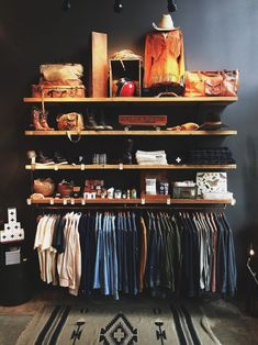 A closet without doors. All you need is some shelves and a rack and you've got yourself a barebones closet that converts your closet into a centerpiece.