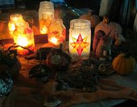 Waldorf window star lantern on a nature table. Ready for Martinmas or St. Martin's Day.