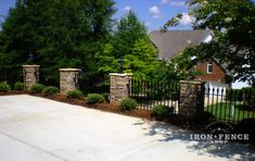 Our 3 foot Stronghold Iron Fence with refined and stylish brick pillars