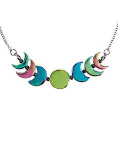 "<p>Who says there cant be rainbows on the moon? Prove them wrong with this rainbow anodized phased of the moon necklace. </p>  <ul> 	<li>14"" chain with 3"" extender</li> 	<li>3"" wide pendant</li> 	<li>Alloy</li> 	<li>Imported</li> </ul>"