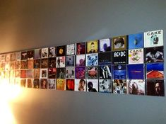 CD Wall Art...attach the cases with 3M adhesive strips.   you could either use CD-Wall products instead of 3M :-)