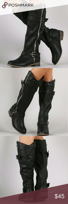 """Zipper Ridding Black Boots These knee high boots features a rounded toe, buckle straps, outer side zipper decor, and low flat heel. Finished with a cushioned insole and side zipper closure  Material: Vegan Leather (man-made) Sole: Synthetic  MEASUREMENT Heel Height: 1.25"""" (approx) Shaft Length: 17"""" (including heel) Top Opening Circumference: 15"""" (approx) Starlight Footwear  Shoes Ankle Boots & Booties"""