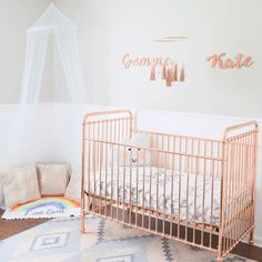 Use rose gold spray paint to update a secondhand crib.