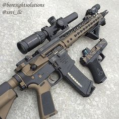 Tan and black AR15 with VLTOR upper and KEYMOD hand guard. Camo tan slide Glock.