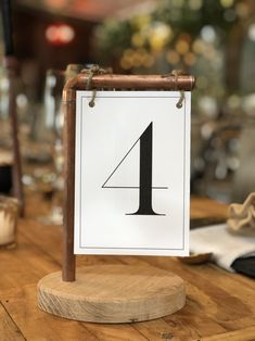 Wood and copper table number / menu holder