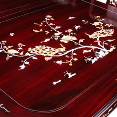 96in Rosewood Mother of Pearl Motif Dining Table with 8 Chairs.  Intricately inlayed with mother-of-pearl flowers decorate the entire table top and the chairs. Dark cherry finish. Oriental Rosewood dining set.
