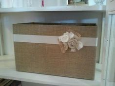 burlap covered bin made from a diaper box,  a cheap alternative to baskets.