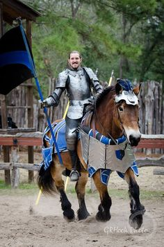 Mark Desmond on the jousting horse Daisy, a Brabant mare, mid-faire competitive jousting tournament, Sherwood Forest Faire 2015 (photo by GRHook Photo)