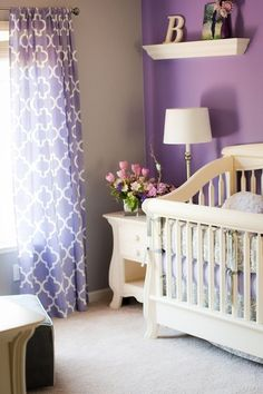 Baby nursery designs to inspire you. Purple drapes against purple walls help the white crib stand out.