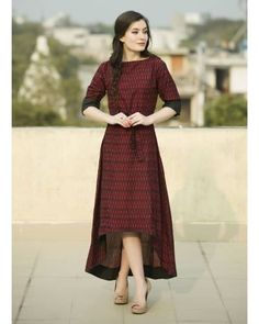 Shop online Sangria straight cape Straight cape in wine red colour. The asymmetrical hemline makes the garment versatile. Wear it as a dress to look young and chirpy. Alternatively, team it with palazzo pants for an elegant look The Secret Label, Wine Red Color, Indian Online, Indian Fashion Designers, Look Younger, Sangria, Hemline, Fashion Online, Women Wear
