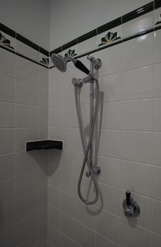 Brodware hand shower on rail, lever mixer.