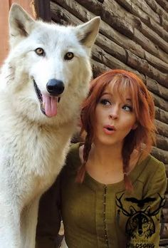 Lindsey Stirling and Mr. Wolf.  Who is excited for the new video that should be out soon? :D