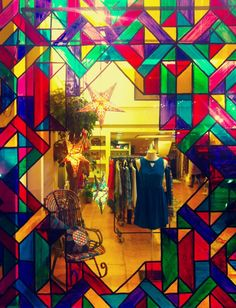 Our window display for Christmas . Hand painted geometric stained glass.