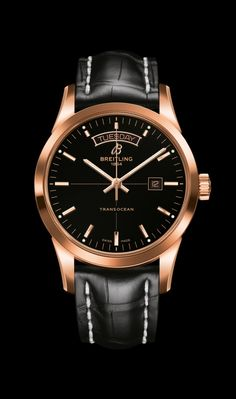 Breitling Transocean Day & Date Selfwinding movement. 18K red gold case. Black dial. Croco strap, 18K red gold tang-type buckle.