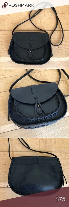 """Ashville Saddle Crossbody Bag In excellent condition. Very beautiful black leather purse with stamped and woven details. Crossbody is adjustable. Measures approximately 8.5"""" across the widest part, 7"""" tall, and 2"""" deep in the mind compartment.  PRICE IS FIRM - NO OFFERS. NO TRADES. Madewell Bags Crossbody Bags"""