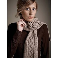 Warm up this winter with this lovely cable knit scarf from Mud Pie! Comes in 10 colorful varieties to complement any outfit.