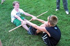 Pioneer And Frontier Games CHEAP GAMES With little Supplies. Games. This game is the Stick Pull. Two participants sit on the grass facing each other. Between them is a thick broom handle. Once the game starts, each participant pulls the stick toward him or her in an attempt to pull the other person off the ground.