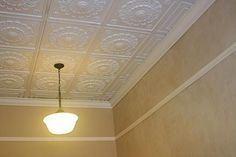 If a tin ceiling is out of your reach, try textured vinyl ceiling tiles.