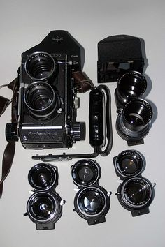 mamiya C330 and lenses, 55mm, 80mm, 105mm, 135mm, & 180mm. With grip, CDS and prism porrofinder ¤ The Mamiya TLR is the only 6X6 TLR with interchangeable lenses. If a shutter should fail on one lens, you can always put another lens on and continue shooting. These cameras were the favorite of wedding photographers that wanted to use a flash for fill light because the leaf shutter syncs at all speeds.