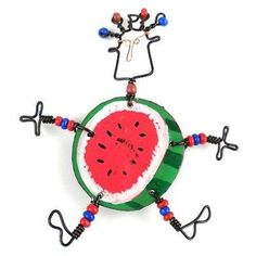 This handmade novelty dancing girl pin features a playful round melon design made from recycled tin can and copper wire, accented with colorful Maasai beads. Pin is approximately 3 inches tall.Meet the Artisans Creative Alterna. Artisan Jewelry, Handcrafted Jewelry, Girls Earrings, Girl Dancing, Red Apple, Decoration, Fair Trade, Kenya, Dance