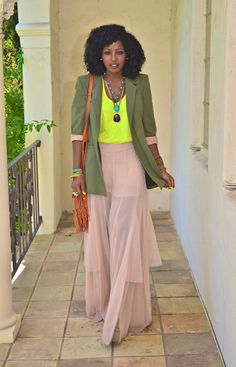 Style Pantry is one of my favourite fashion bloggers. Here, she is wearing a boyfriend blazer, neon tank, and chiffon maxi. I love the entire look.