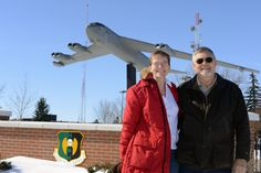 Maj.Nickole Lensgraf,705th Munitions Sqdn missile maintenance officer in charge of B-52 munitions, poses with her dad, Terry Hanscam on Minot Air Force Base, N.D., Feb. 27, 2015. Hanscam is a Vietnam veteran who tracked B-52s from the USS Goldsborough guided missile destroyer. A B-52 from Minot Air Force Base is scheduled to fly over a ceremony commemorating the 50th anniversary of the Vietnam War March 2, 2015 at the Air Force Memorial in Washington D.C.(USAF Senior Airman Brittany…