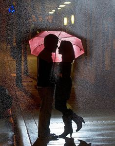 Romantic couples in the rain