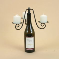 Bottle Candelabra- A trio of slender candles perched around a wine bottle creates an elegant centerpiece that is truly one-of-a-kind!