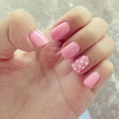 Pink and polka dotted.