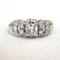 Vintage 1940s Buckle Motif Diamond Ring in 18K White Gold by AJMartinJewelry on Etsy https://www.etsy.com/listing/460101874/vintage-1940s-buckle-motif-diamond-ring