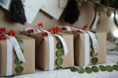 brown paper packages with red berries