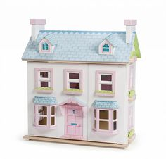 A deluxe, painted and decorated large 2 storey wooden doll house by Le Toy Van with attic windows and chimney stacks, large bay windows, a loft ladder and more. Wooden Dollhouse, Wooden Dolls, Dollhouse Furniture, Dollhouse Ideas, Van Kitchen, Painting Shutters, Roof Panels, Le Palais, Large Homes