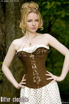 Bitter Chocolate. Delicious overbust corset based on a 19th century pattern. This corset features a spoon busk  and is hand embroidered with a pretty floral pattern. Custom made by Julina. 390 euros