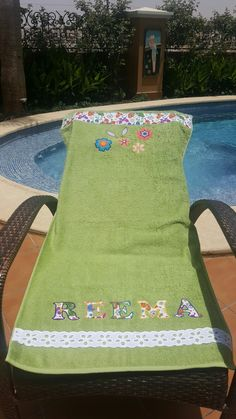 Pool towel with appliqué name and flowers