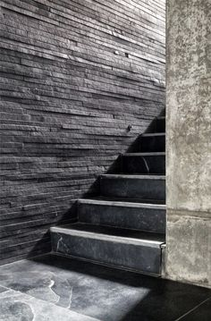 The House Cast in Liquid Stone by SPASM Design Architects. Layered slices of stone to create a wall cladding