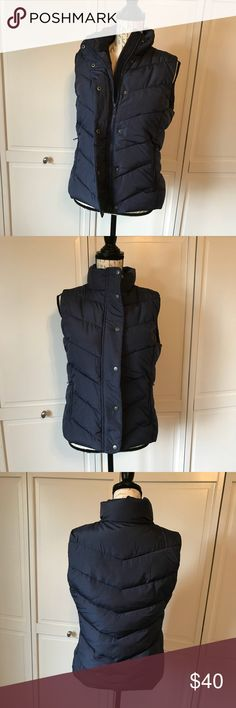 """NWOT Gap puffer vest NWOT navy with white polka dots. Super cute and warm! Just not my style, but I took the tags off so I couldn't return it. Zipper and snap closure. 2 side zipper pockets. Bust is approx 19"""". Length is approx 23"""". Smoke free home. GAP Jackets & Coats Vests"""