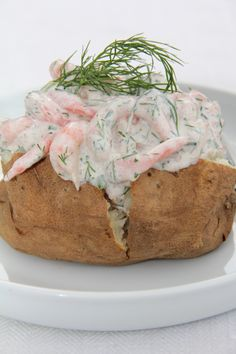 Baked Potato with Skagenröra, a yummy Swedish classic. Skagenröra is Swedish shrimp mixed together with creme fraiche, caviar, and dill.