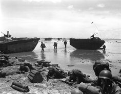 Marines land on coral reefs during U.S./Japanese warfare, Guam, Mariana Islands, Jul. 21, 1944. (AP Photo/Joe Rosenthal)