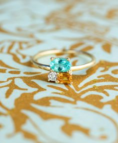 The Paraiba Cluster Ring, ready to ship for a Holiday proposal. Sure it looks beautiful here, but believe us when we say no photograph does it justice. Paraiba tourmaline gemstones are some of the most precious and valuable in the world. The rarest of the rare.  This is the only one.