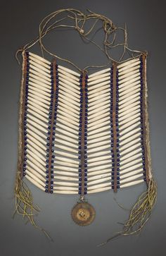 A CHEYENNE BREAST PLATE. c. 1880... American Indian ArtPipes, | Lot #50285 | Heritage Auctions