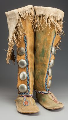 """A PAIR OF KIOWA BEADED HIDE BOOT MOCCASINS. c. 1880... (Total: 