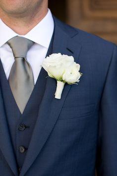 elegant navy blue groom suit with gray tie