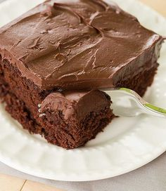 """Chocolate Cake with Whipped Mocha Ganache Frosting (recipe from Barefoot Contessa) - """"a very simple chocolate cake that has a devil's food flavor to it, and is topped with the most amazing whipped ganache frosting. With espresso powder and Kahlua, it's certainly not for the faint of heart!"""""""