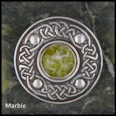Sterling Silver brooch with stones