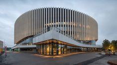Copenhagen arena by 3XN has an undulating wooden facade that rises up above entrances  https://www.dezeen.com/2017/11/21/3xn-royal-arena-undulating-wooden-facade-copenhagen-denmark-architecture/