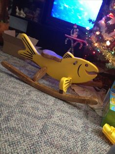 Rocking horse nope rocking fish for this fella!!  Homemade wooden toy from Uncle Doug